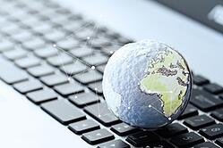 hand drawn texture globe with social media diagram on laptop computer as internet concept